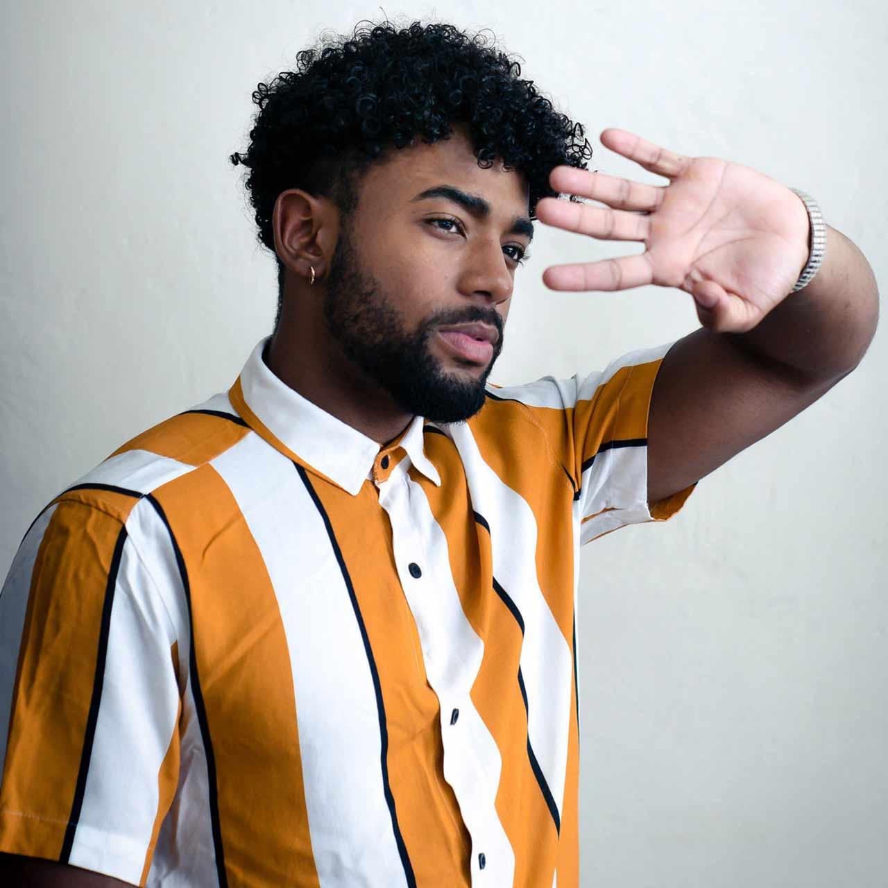 man-wearing-orange-and-white-striped-polo-shirt-3266352
